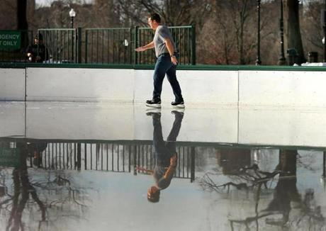 Paul Mueller from Houston, Texas, skated in his t-shirt on the watery ice of the Boston Common Frog Pond on Thursday.